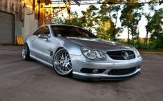 Roger's Silver Mercedes-Benz SL 55 AMG. Growing up poor, in and out of foster homes, had made him very aware of appearances. These days he reeked of success in every way.