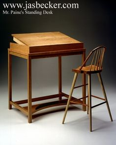 Standing Desk for Mr. Paine by Jas. Becker Cabinetmaker of Manchester Center, Vermont. Cherry with a half-round piece of birdseye maple to keep the pencils from rolling when the top is tilted. Brushed brass scuffplate. http://www.vermontfurnituremakers.com/vt-custom-furniture/standing-desk-mr-paine