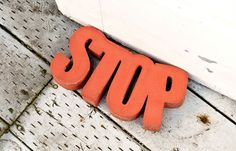 DIY Door Stop   This Instructable will show you how to make a concrete door stop using a piece of 2″ thick insulating foam. #diyready www.diyready.com