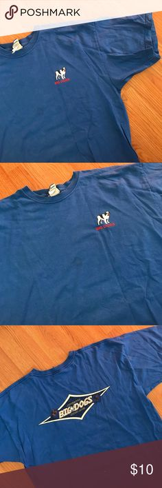 ▪️v i n t a g e  big dogs t-shirt v i n t a g e  bright blue Big Dogs brand shirt. Good condition, discoloration/faint stain on the front near the logo but hard to notice. Bright blue, thick heavy cotton fabric. Oversize. Size 2xl.  ——- #sale #deal #clearance #gift #present #vintage #vtg #retro #freeship #bogo #shopmycloset  #blue  #bigdogs  #santabarbara Vintage Shirts Tees - Short Sleeve