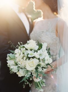 jen huang; san francisco wedding; california wedding; northern california; bluxome street winery; Michael Daigian Design; badgley mishka; classic wedding; elegant wedding; restaurant wedding; bride and groom pose with bride's white and green bouquet; white and green bouquet;