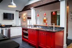 Astonishing Red Paint For Kitchen : Awesome Kichen Design With Red Painted Wood Cabinet Black Marble Countertop Quarry Tile Floor White Pain...