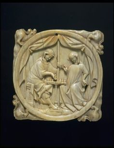 A French ivory mirror case, 1300-25, depicting a knight and a lady playing chess; chess symbolised love and war in the Middle Ages; the mirror shows an allegory of desire (click through for further details). (Victoria & Albert Museum)
