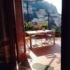 Start off your weekend on this beautiful terrace in #Positano, Italy overlooking the sea and the hillside homes. #airbnb #Italy #travel Photo: @vincenard1  Listing: airbnb.com/rooms/921966