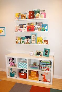 Ikea bookshelf and picture shelves, office wall idea.. Original Pinner--My sister's nursery for her newborn, Harper