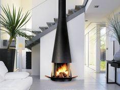 Cette cheminée aux lignes et formes harmonieuses viendra embellir et réchauffer comme il se doit votre pièce à vivre. http://www.m-habitat.fr/cheminees/styles-de-cheminees/notre-selection-de-cheminees-16_R?&image=2