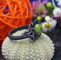 A delicate, unique, handmade, wire wrapped ring with green Jadeite.  Ring was designed and made by Me, using an extremely labor-intensive and precise wire-wrapping technique, with silver 925, 930 and 999. Silver strongly oxidized and polished to emphasize the braid tangles. On a buyers request size can be adjusted by plus 1 or minus 1.  Dimensions: Jewelry Size: 17 EUR ( 7,5 USA ) Inner diameter: 18 mm Width of ring: 3 mm  You receive this unique ring in jewelry box, so it is ready to be a…
