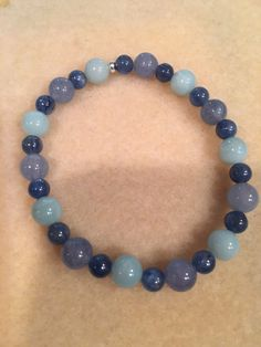 THYROID: Amazonite, Aquamarine & Kyanite Round Stretch Bead Bracelet with Sterling Silver Accent https://www.etsy.com/listing/467803344/thyroid-amazonite-aquamarine-kyanite