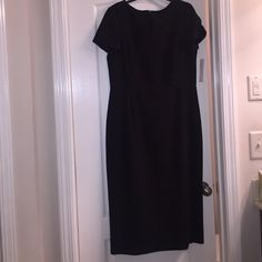 NWT's Black Dress NWT's Preston and York Black dress. Shell: 64% polyester 34% Rayon 3% spandex Lining: 100% polyester.3/4 zipper in back. Approximately 45 inches from neck online to bottom of dress. Approximately 19.5 inches from armpit to armpit. Preston & York Dresses