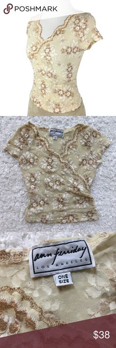 Ann Ferriday stretch lace surplice crop top Super sexy little semi-sheer tan nylon stretchy mesh top with metallic bronze and white floral lace design. Has cap shelves and v-neck surplice cropped style. Sized one size but fits like an xs! Pre-loved with minor wear but still in good condition! I previously paid $75 for this at Nordstrom's but unfortunately doesn't fit my body shape any longer. Please read my about me and my closet listing prior to any inquiries. Ann Ferriday Tops Crop Tops