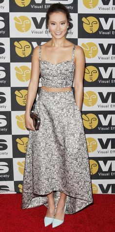Jamie Chung bared her midriff at the 13th Annual VES Awards in a black-and-white floral jacquard Noir Sachin & Babi bustier and matching full high-low skirt, accessorizing with Ippolita blue topaz earrings, a gunmetal clutch, and aqua blue Rene Caovilla pumps