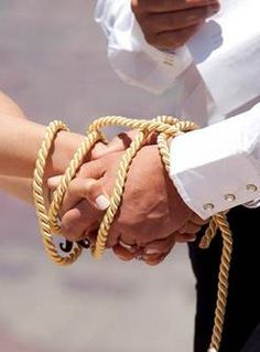 The Western version of handfasting ceremony--use a country rope.