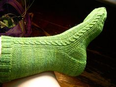 """Finished Measurements: Leg circumference = 8.5""""; unstretched. Foot circumference = 8""""; unstretched. This pattern (and this yarn) is rather stretchy, owing to both the stockinette and the cable action. And because of all the stockinette, the size can easily be altered by subtracting up to 24 stitches if necessary."""