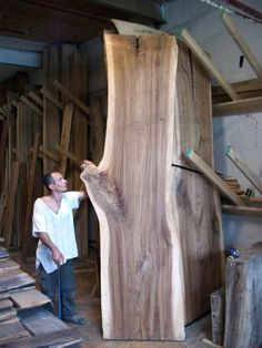 Our live-edge slabs are primarily salvaged from Toronto, cut by hand and air-dried.