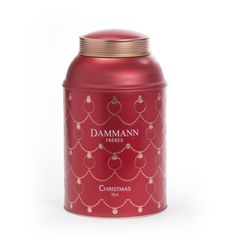 Dammann Frères [Dammann Freres] Christmas Tea tea tin ... gold on red garland and ornament pattern on round canister shape with sloping shoulders and cap lid, 2015, France