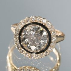 Pink Gold and Diamond Art Deco Engagement Ring. Usually I hate black on rings but this is pretty!!
