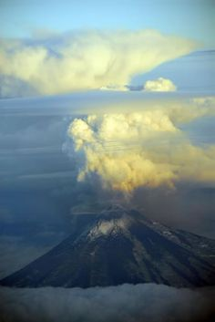 Pavlof volcano and an eruption plume photographed from a commercial flight on August 30, 2007. The plume is about 17,000 feet tall. Little Pavlof is the smaller peak on Pavlof's right shoulder.