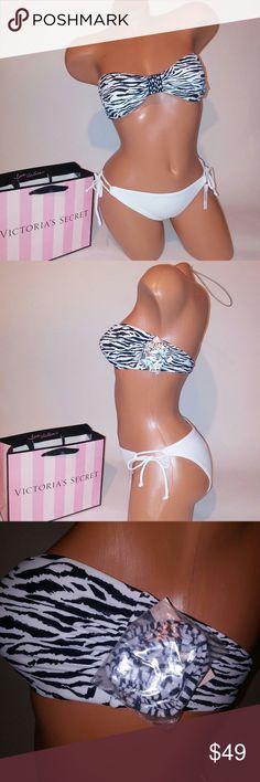 Victoria Secret Swim Suit Bikini Victoria Secret Swim Suit Bikini  Small top Bandeau includes straps White small bottom Animal print Removable padding New with tags  *Bundle to Save  Chavonne11 Victoria's Secret Swim Bikinis