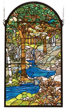 40 Inch H X 22 Inch W Tiffany Waterbrooks Stained Glass Window - 40 Inch H X 22 Inch W Tiffany Waterbrooks Stained Glass WindowMeyda's interpretation of Louis Comfort Tiffany'sWaterbrooks window is made using hand cut glassindividually wrapped in copper foil. A beautifulselection of stained art glass in neutral tones ofEarth Browns, Verdant and Mottled Greens, RussetOranges and rippling Azure were hand selected to create this masterpiece. A solid brass hanging chain andbrackets are included…