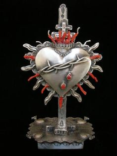Corazon de Santa Fe, sacred heart brooch displayed on removable cross. Award-winning piece.