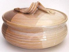 Tortilla Warmer - Desert's Edge Glaze by Rising Sky Pottery. $58.50. Food Safe. Oven Safe. Handmade Stoneware. Microwaveable. Dishwasher Safe. Hand-thrown porcelain tortilla warmer, or vegetable casserole by New Mexico potter R. Rising of Las Cruces. Approximately 5 inches tall and 9 inches in diameter. The colour shown is called Desert's Edge.  Microwaveable, lead free, and oven safe. Fired to 2400F., footed and signed 'Rising, Las Cruces'.