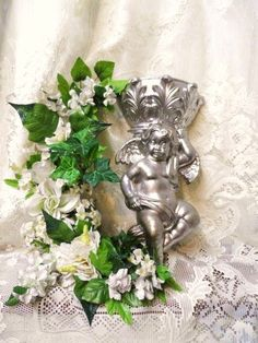 Check out this item in my Etsy shop https://www.etsy.com/listing/254833594/cupid-cherub-angel-putto-putti-wall