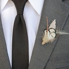 Feather Boutonniere // Edyta Szyszlo Photography //  Boutonniere: Pomp and Plumage // http://www.theknot.com/weddings/album/a-romantic-outdoor-wedding-in-san-martin-ca-143618