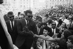 """Ali during a weeklong protest against the Vietnam War draft in San Francisco, 1968  -  Tommie Smith: """"The blink in his eye when he was socially bound and stripped from his heavyweight boxing title."""" Tommie Smith is a former Olympic athlete in track and field."""