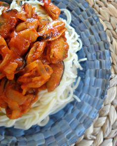 Spaghetti with mussels cooked in ouzo and tomato sauce