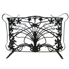 Solid Black Wrought Iron Art Nouveau Grille | From a unique collection of antique and modern fireplace tools and chimney pots at http://www.1stdibs.com/furniture/building-garden/fireplace-tools-chimney-pots/