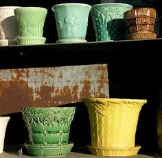McCoy flower pots; I love the little brown one on the top right. I collect those (in various sizes and colors)