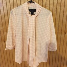 Kardashian Kollection houndstooth top Cute pink/cream houndstooth blouse. Cute tie around the neck Kardashian Kollection Tops Blouses