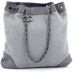 Pre-Owned Chanel CC Charm Drawstring Tote Boucle and Python Medium ($920) ❤ liked on Polyvore featuring bags, handbags, tote bags, blue, blue tote, lightweight tote bag, chanel handbags, handbags totes and tote purses