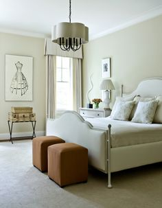 Another example of the neutral room with just a spatter of color, the two ottomans and again, that important vase of fresh flowers. Esp. nice for your house guest. Makes them feel welcome and pampered.