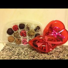 This is my first attempt at truffles for a very last minute Valentines gift. They were pretty easy. I made dark chocolate and  bittersweet ginger and coated them in pistachio, almonds, cocoa powder and of course red and pink sprinkles.  The heart and lips containers were on sale at Target for 50 cents each. Heart Cookie Cutter, Heart Cookies, Cookie Cutters, Valentine Gifts, Valentines Day, How To Make Cookies, Almonds, Pistachio