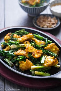 Vietnamese turmeric fish with noodles (Cha Ca La Vong) is an iconic dish of Hanoi. Chunks of flavorful fish are plated on a bed of scallions and dills. #vietnamese #fish #noodle