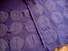 This purple scarf is made from a t-shirt with Sashiko stitches