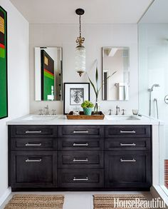 On the vanity, Barbara Barry's sinks for Kallista are paired with Bistro faucets by Restoration Hardware. Wall paint is Sherwin-Williams Bath in Neutral Ground, and ceiling paint is Benjamin Moore Waterborne Ceiling in Swiss Coffee.   - HouseBeautiful.com