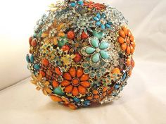 This is a Brooch Bouquet but wonder if I could make a garden gazing ball like this