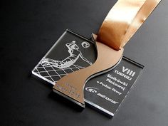 Medal - a beach volleyball tournament Plexiglas colorless and brown laminate engraving .