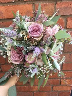 Bridal bouquet muted lilacs tones and silver foliages #amnesiarose #waxflowers #mentha #pennyjohnsonflowers #birminghamflorist #weddingflorist #weddingflowers