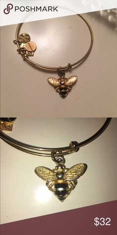 Alex and Ani bumblebee bangle Aging gold finish UNICEF bumblebee bangle. Has some tarnishing on the bee shown in the second picture Alex & Ani Jewelry Bracelets
