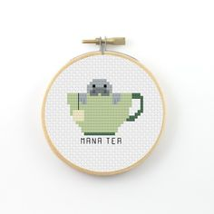 Mana Tea cross stitch pattern (instant download) ----------------------------------------------------- Pattern information: Fabric: 14 count Aida white Stitches: 42*42 Size: Width: 3 (7,6 cm) Height 3 (7,6 cm) 8 DMC Colors Used stitches : cross stitch and back stitch 2 PDFs Included: - preview image of the finished design - colour symbol chart - black and white symbol chart - color floss legend with DMC stranded cotton ----------------------------------------------------- Instant D...