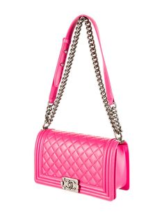 Hot pink quilted leather Chanel Medium Boy Bag with antique silver-tone hardware, front flap closure and chain shoulder strap.