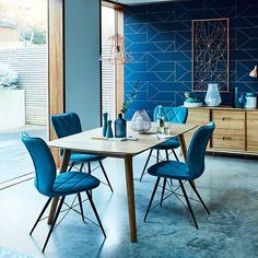 Classic Scandi shapes with a hint of colour. Shop our Lund Dining Table and Flynn Chairs.