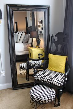 gorgeous bedroom in blacks and grey with a pop of yellow! Featured Premier Fabrics: Chipper Black (wall art), Large Houndstooth (chair & ottoman)