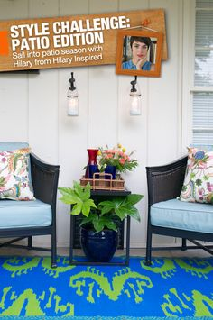 A colorful rug, patterned pillows and greenery combine in a gorgeous front porch makeover.