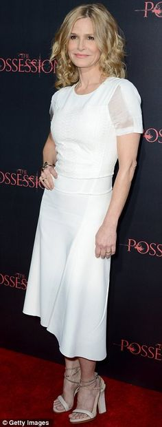 Kyra Sedgwick in a lovely white dress.