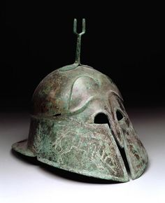 Corinthian type helmet with boars. Date: 6th-5th century BC. Geographic location: Italy. Culture: Etruscan.