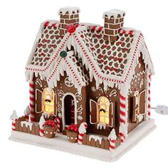 Nothing is more fun than Gingerbread for Christmas! Product Features Made of Plastic Measures 11 inch X 9 inch X inch Red, green and white candy on a brown gingerbread house with Lots of Peppermint! Plug In A Must Have for the Christmas Season! Best Gingerbread House Kit, Cool Gingerbread Houses, Gingerbread House Designs, Gingerbread Cookies, Christmas Cookies, Christmas Crafts, Xmas, Gingerbread Castle, Christmas Ornaments